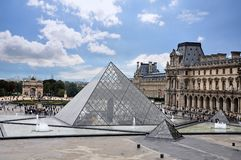 Louvre Museum in Paris, France. Historic castle and palace. stock photos