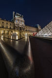 Louvre Museum. Paris, France - March 27, 2015: Louvre Pyramid at Louvre Museum by night. The Louvre is one of the most famous museum in the world Royalty Free Stock Images