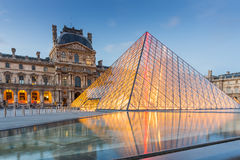 Louvre Museum in Paris, France. Paris, France - May 13, 2014: The Louvre Museum is one of the world's largest museums and a historic monument. A central Royalty Free Stock Photography