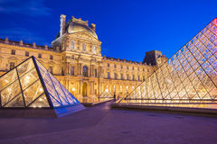 The Louvre Museum in Paris. Paris, France - May 13, 2014: The Louvre Museum is one of the world's largest museums and a historic monument. A central landmark of Stock Images