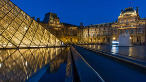 Louvre Museum in Paris, France. The Louvre Museum is one of the world`s largest museums and a historic monument. A central landmark of Paris, France Royalty Free Stock Images