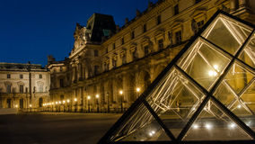 Louvre Museum in Paris, France. The Louvre Museum is one of the world`s largest museums and a historic monument. A central landmark of Paris, France Stock Images
