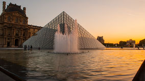 Louvre Museum in Paris, France. The Louvre Museum is one of the world`s largest museums and a historic monument. A central landmark of Paris, France Stock Photo