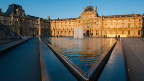 Louvre Museum in Paris, France. The Louvre Museum is one of the world`s largest museums and a historic monument. A central landmark of Paris, France Stock Photos