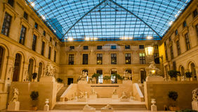Louvre Museum in Paris, France. The Louvre Museum is one of the world`s largest museums and a historic monument. A central landmark of Paris, France Royalty Free Stock Photo