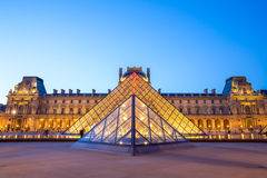 Louvre Museum Paris. Paris - June 18: Louvre museum at dusk on June 18, 2014 in Paris. This is one of the most popular tourist destinations in France displayed Stock Photos