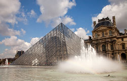Louvre Museum, Paris. Louvre Museum with Pyramid in Paris daytime Royalty Free Stock Image