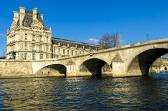 Louvre Museum in Paris from the Seine river Stock Images