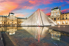 Louvre Museum in Paris at sunrise, France Stock Photos