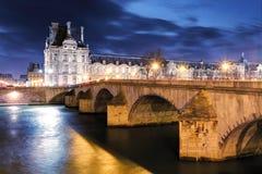 Louvre Museum and Pont des arts, Paris - France Stock Photography