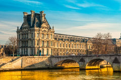 Louvre Museum and Pont ses arts, Paris - France Stock Photo