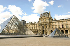 Louvre Museum and the pyramid stock images