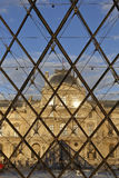 Louvre Museum Pyramid as seen through pyramid glass at sunset, Paris France, August 5, 2015 Royalty Free Stock Photo