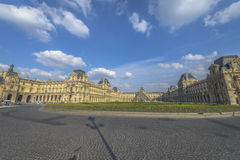 Louvre museum and Pyramid by day Royalty Free Stock Photos