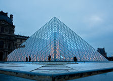 Louvre Museum Pyramid at dusk Royalty Free Stock Image