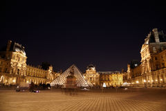 Louvre museum, Pyramid and equestrian statue Stock Image