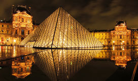 Louvre museum and Pyramid at night. Paris, France - October 15 : Louvre museum and Pyramid at night on October 15,2010. Louvre is the biggest Museum in Paris Stock Image