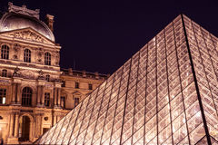 Louvre Museum Pyramid at night in Paris. Stunning architecture and culture in Paris stock images