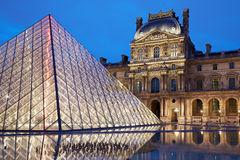 Louvre museum and pyramid, night in Paris Royalty Free Stock Photo