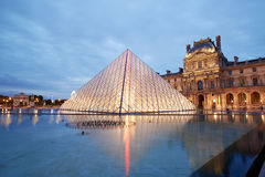 Louvre museum and pyramid night view Royalty Free Stock Photos