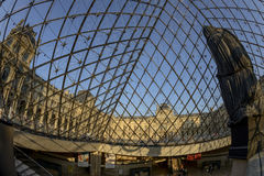 Louvre Museum through the Pyramid Royalty Free Stock Photography