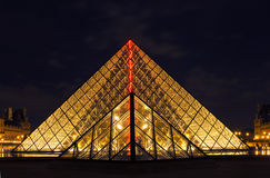Louvre Museum and the Pyramid in Paris, at night Royalty Free Stock Photo