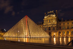 Louvre Museum and the Pyramid in Paris at night Royalty Free Stock Photography