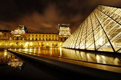 Louvre Museum and Pyramid night view, Paris, France Stock Image