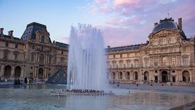 Louvre museum with pyramid at sunset stock footage