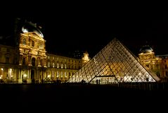 Louvre museum and pyramids Stock Photo