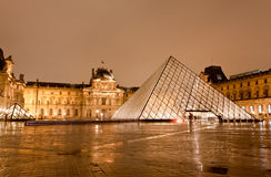 The Louvre Museum at the rainy night Royalty Free Stock Photo