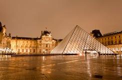 The Louvre Museum at the rainy night. PARIS - DECEMBER 7: The Louvre Museum at the rainy night on December 7, 2010 in Paris France.The Louvre is the biggest Royalty Free Stock Photo