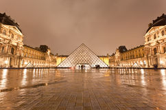 The Louvre Museum at the rainy night Royalty Free Stock Photos
