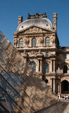 Louvre Museum. The Louvre Museum reflected in its pyramid. Paris, France Royalty Free Stock Image