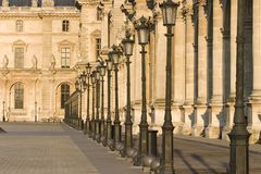 Louvre museum row of lamps - France - Paris Royalty Free Stock Photography