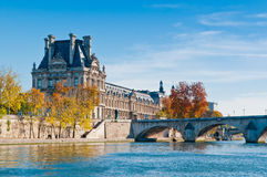 The Louvre Museum and the Seine River. The Louvre Museum as seen from the Seine River Royalty Free Stock Photo