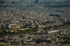 """Louvre Museum, Seine River and buildings in a sunny day, seen from the Eiffel Tower top in Paris. Known as the """"City of Light"""", is one of the most Royalty Free Stock Photo"""