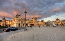 Louvre museum at sunset. PARIS - SEPT. 22: Louvre museum building on September 22, 2011 at Louvre museum, France. It is consistently the most visited museum in Royalty Free Stock Image