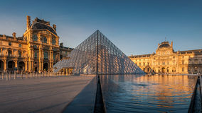 Louvre museum at sunset. Paris, France - April 14, 2013: Louvre museum at sunset. Louvre Museum is one of the world's largest museums, every year museum visits Royalty Free Stock Image