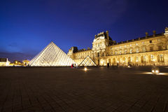 Louvre museum at twilight Stock Photos