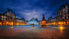 Louvre museum at twilight time. FRANCE, PARIS - APRIL 14 : Louvre museum at twilight time on April 14, 2013 in Paris, France. The photographer take a picture in Royalty Free Stock Image