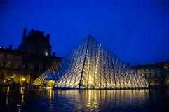 Louvre museum at twilight. In winter. Louvre museum is one of the world's largest museums with more than 8 million visitors each year Stock Photos