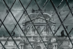 Louvre museum, view through the glass pyramid Stock Photo