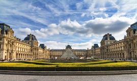 Louvre overview. Beautiful view of the Louvre in Paris on a cloudy winter day Royalty Free Stock Photo