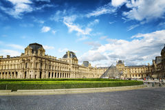 The Louvre Palace and the Glass Pyramid in Paris Stock Photo