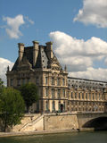 Louvre palace, Paris, France. Louvre palace near Sena river, with blue sky in the background Stock Image