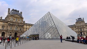The Louvre Palace and the Pyramid in Paris Stock Photos