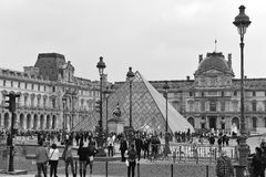 The Louvre Palace and the Pyramid in Paris Stock Photography