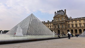 The Louvre Palace and the Pyramid in Paris Royalty Free Stock Photo