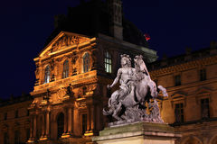 Louvre Palace and statue of Louis XIV, Paris Stock Photos